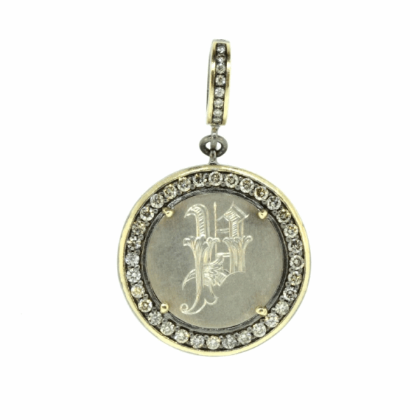 """Closeup photo of Love Token Engraved with """"P"""""""