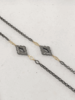 Collection: Old World Style #: 04593 Description: Blackened sterling silver and 18k yellow gold petite oval cravelli cross earrings with Malachite/London Blue topaz and white diamonds on blackened sterling silver cravelli huggie.Metal: .925 Sterling SilverS/18k Yellow Gold