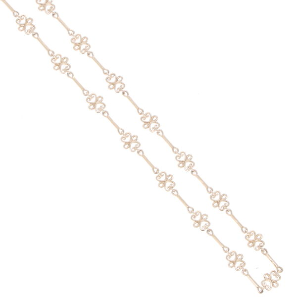 """Closeup photo of Scroll Yellow Gold Link Chain 32"""""""