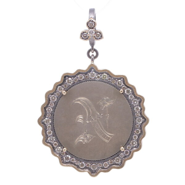 "Closeup photo of Love Token Engraved With ""N"""