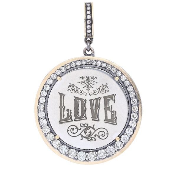 """Closeup photo of Love Token Engraved With """"Love"""""""