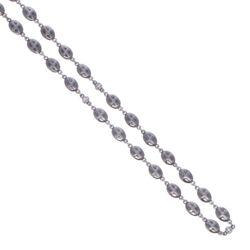 "Closeup photo of Polished Cross Shield Chain With Black Diamond Stations 34"""