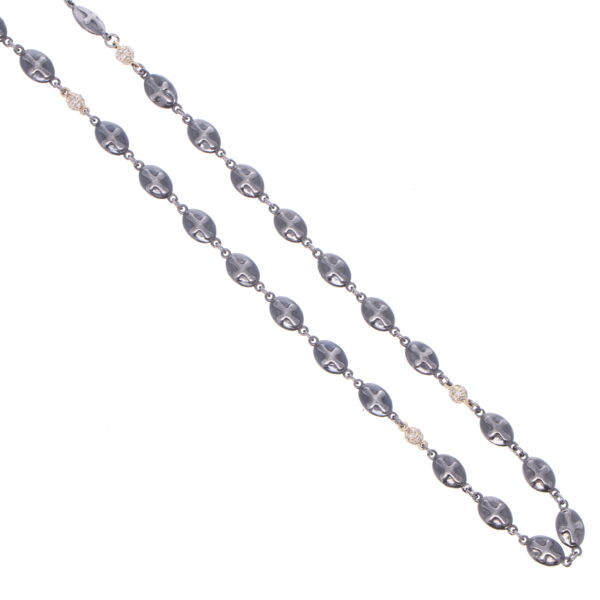 Closeup photo of Polished Cross Shield Chain With Yellow Gold Diamond Stations 30""