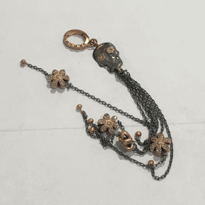 This Ancient Viking Bell found in the Ukraine, dates back to 9-10 AD. Viking believed that noise making kept evil spirits away, so they often wore small bells. The bell would have been attached to a bronze chain and worn as a pendant, necklace or headdress accessory.  Ancient Viking Bell Pendant Topped with a Champagne Diamond and Yellow Gold Crown with Cross Details, Hanging from a Champagne Diamond and Yellow Gold Openable Bale. 109 Champagne Diamond - 0.68ctw 14k Yellow Gold - 6.97g