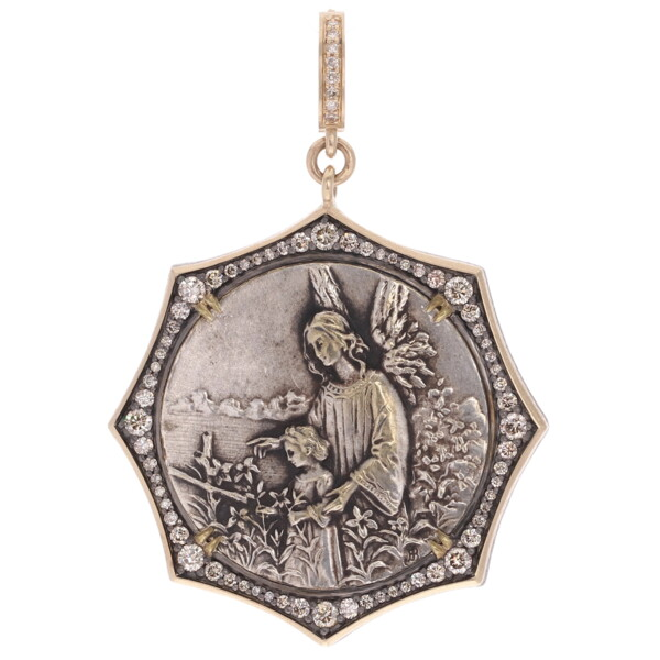 Closeup photo of Antique French Guardian Angel & Child Pendant