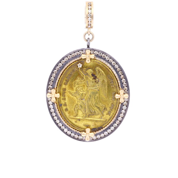 Closeup photo of Antique French Brass Guardian Angel Medal Pendant