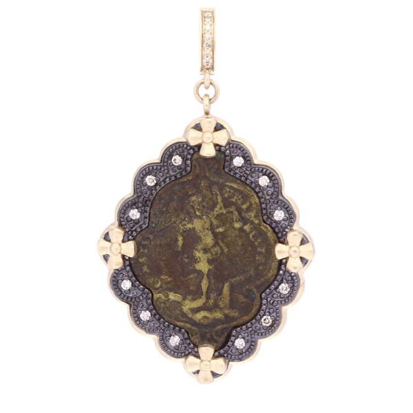 Closeup photo of Antique St. Michael Medal Pendant