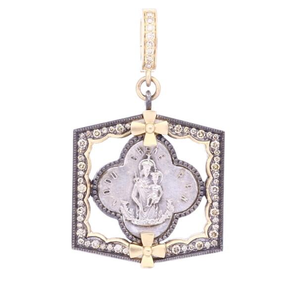 Closeup photo of Antique Virgin Mary Clover Medal