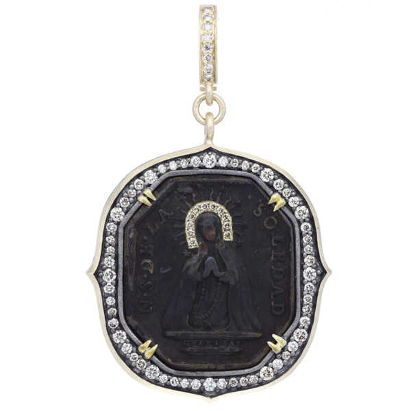 Closeup photo of Antique Virgin Mary Medal Pendant