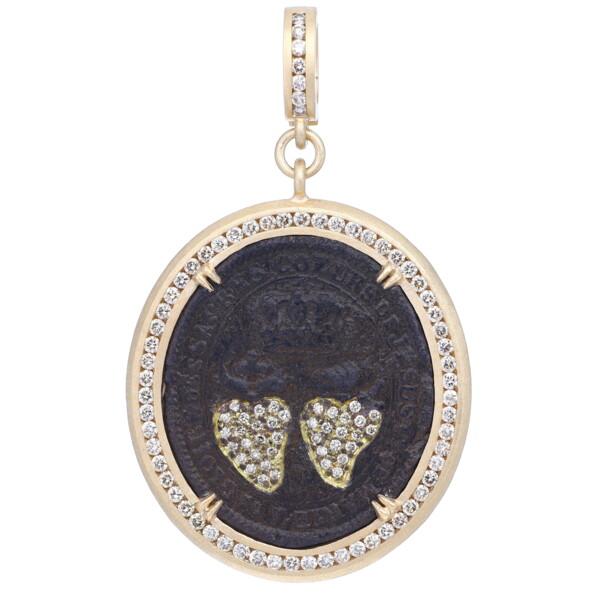 Closeup photo of Antique Double Sacred Heart Pendant