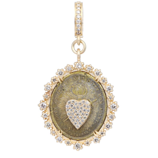 Closeup photo of Antique Sacred Heart Medal With Heart Decal