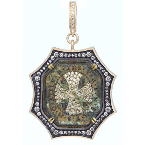 Closeup photo of Antique Octagon St Benedict Medal w/ Cross Inlay