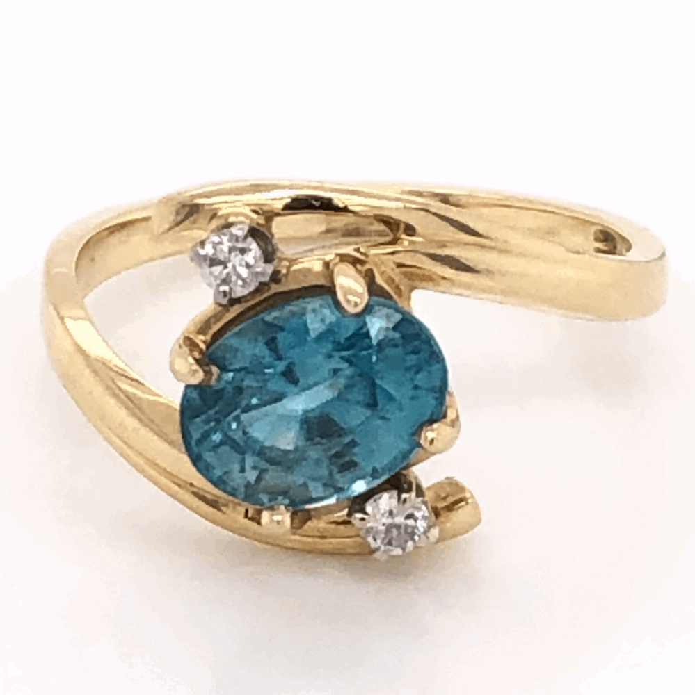 14K Yellow Gold 1.25ct Oval Blue Zircon Ring with .05tcw diamonds, 3.1g, s6