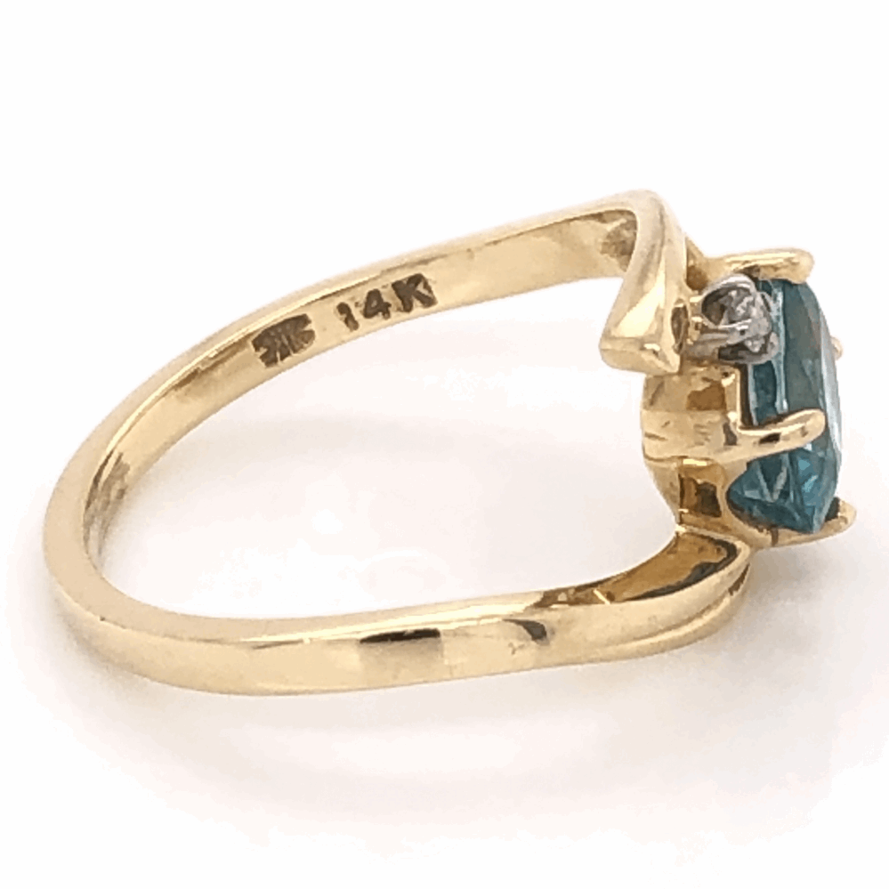 Image 2 for 14K Yellow Gold 1.25ct Oval Blue Zircon Ring with .05tcw diamonds, 3.1g, s6