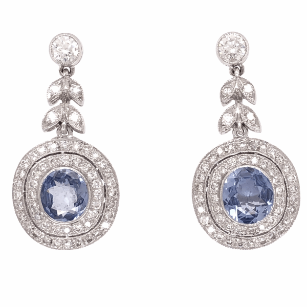 Closeup photo of Filligree and Milgrain earrings 18K Gold with Sapphire and Diamond