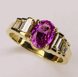 Closeup photo of 18K Yellow Gold 1.70ct Oval Pink Sapphire Ring .33tcw baguette diamonds 5.4g