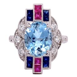 Closeup photo of 18K White Gold 2.53ct Oval Aquamarine Ring with .20tcw diamonds and .65tcw Sapphire/Ruby