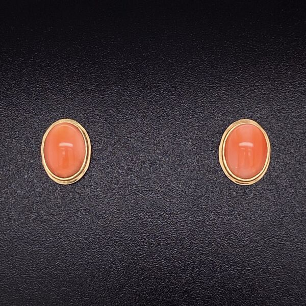 """Closeup photo of 14K Yellow Gold Oval Cabochon Coral Stud Earrings 3/8"""" Tall"""