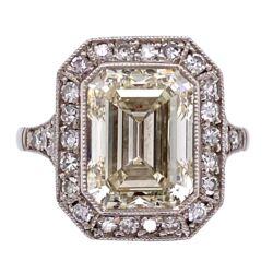 Closeup photo of Platinum Art Deco 4.01ct Emerald Cut & .45tcw side diamond Ring