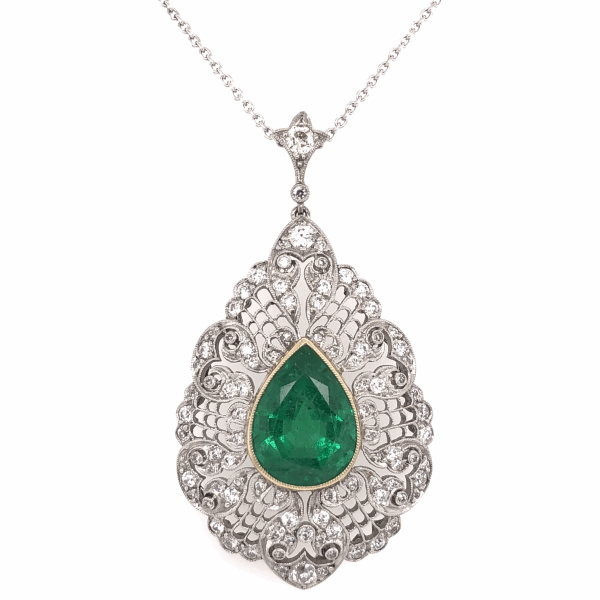 "Closeup photo of Platinum & 18K Yellow Gold 5.10ct Pear Shape Emerald GIA & 1.50tcw Diamond Pendant 16"" Chain"