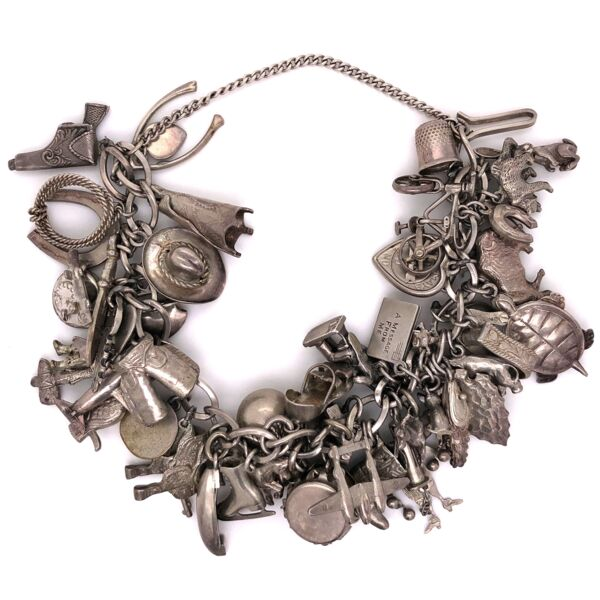 "Closeup photo of 925 Sterling Vintage 50 Piece!!! Charm Bracelet 7.5"" Long 91.5g"