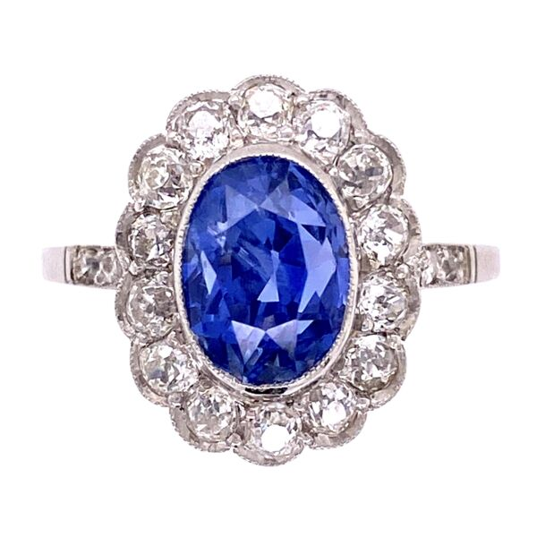 "Closeup photo of ""Princess Diana"" Sapphire Ring in Platinum with Diamond Halo"