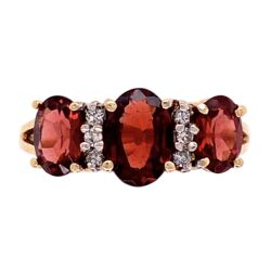 Closeup photo of 10K YG 3 Stone Garnet & Diamond Ring 3.3g