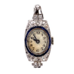 Closeup photo of Platinum on 14K Art Deco Watch Ring with Diamonds and Sapphires