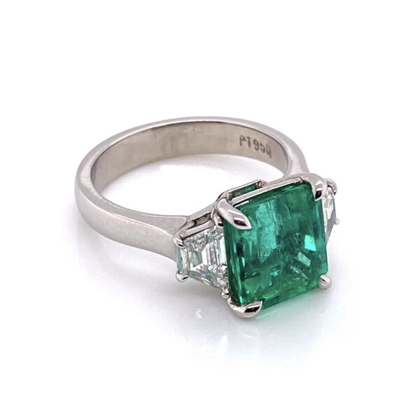 Closeup photo of Platinum 3.55ct Emerald & 2 Trapezoid Diamonds .66tcw Ring, s6.5