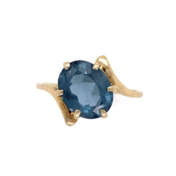 Closeup photo of 10K YG Bypass Ring with 2.5ct Oval London Blue Topaz Ring 2.4g, s7.5