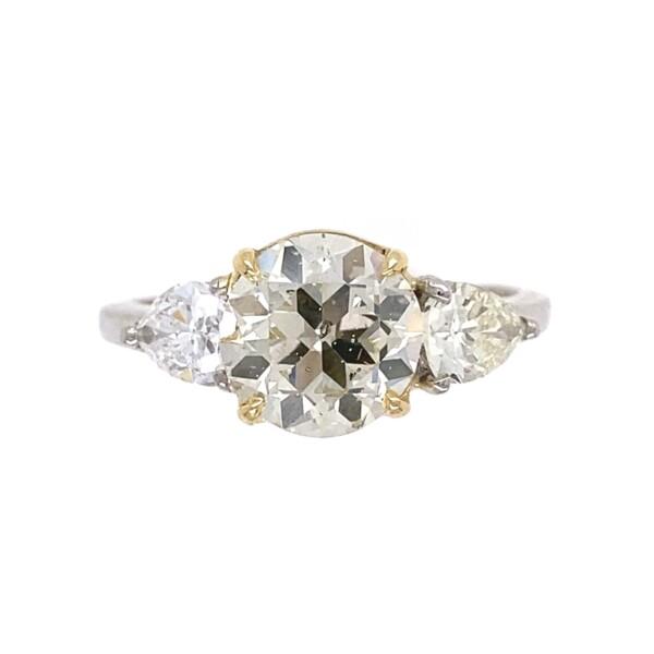 Closeup photo of 1.92ct Light Yellow Old European Cut Diamond & 1.00tcw Pear Diamond Ring, s6.75