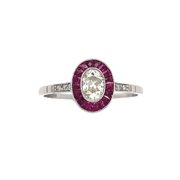 Closeup photo of Platinum Antique .33ct Oval Diamond & French Cut Ruby Ring, s7.25