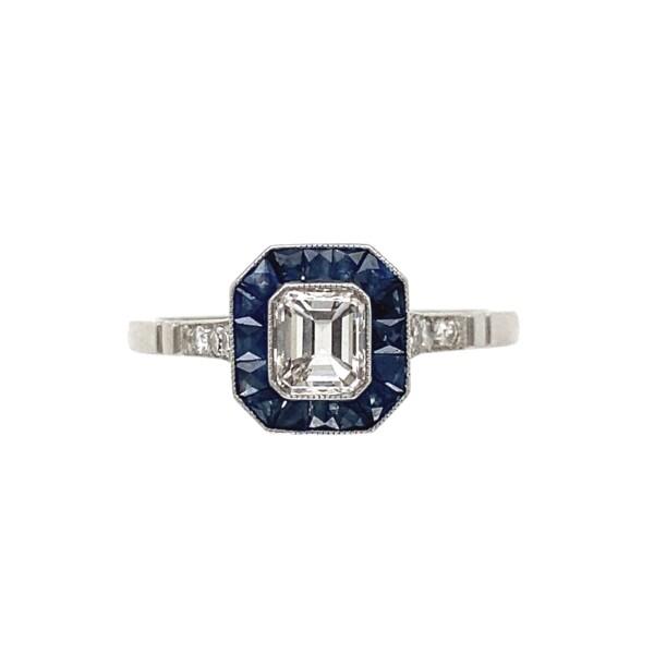 Closeup photo of Platinum .55ct Emerald Cut Diamond & 1.00tcw Sapphire Ring, s7.25