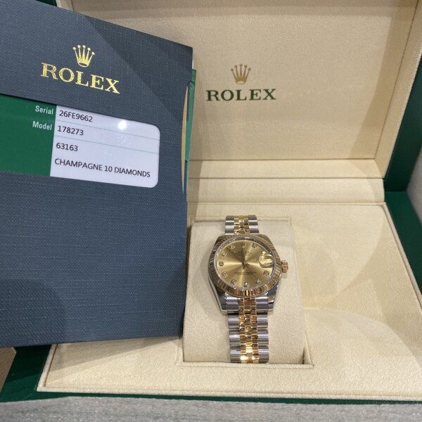 Closeup photo of Rolex 2tone 178273 31mm Champagne Diamond Dial 26FE9662 Card and Booklets