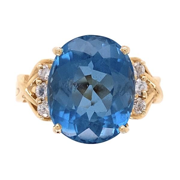 Closeup photo of 14K YG 6ct Oval Blue Topaz & .25tcw Diamond Ring  7.2g, s8.25