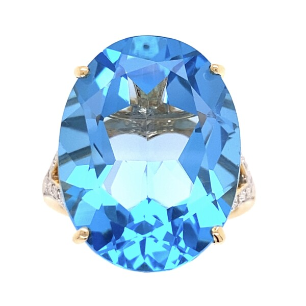 Closeup photo of 14K 11ct Oval Blue Topaz & .12tcw Diamond Ring 8.8g, s7