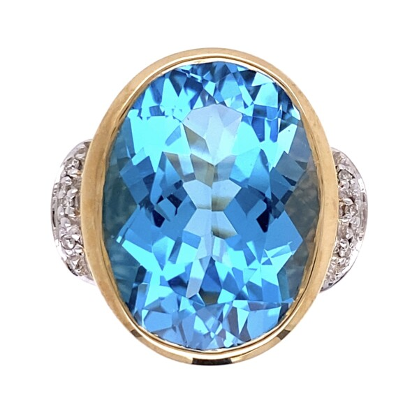 Closeup photo of 14K YG 14.30ct Oval Blue Topaz & .02tcw Diamond Ring 9.2g, s7