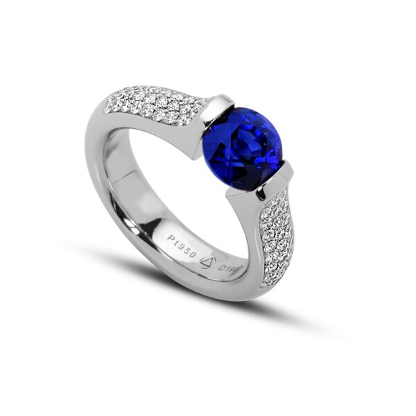 Closeup photo of 2.33 ct. Blue Sapphire set in Omega 3-Row Pave Ring