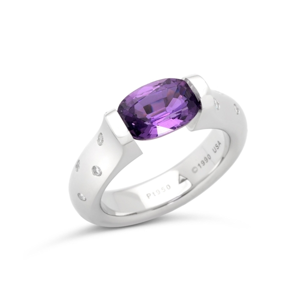 Closeup photo of 2.50 ct. Purple Sapphire set in Omega Scattered Melee Ring