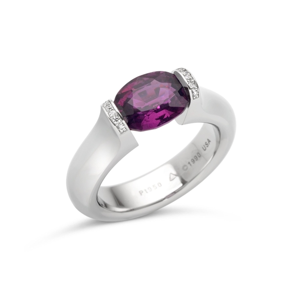 Closeup photo of 3.00 ct. Magenta Sapphire set in Omega Round with Pave Lips Ring