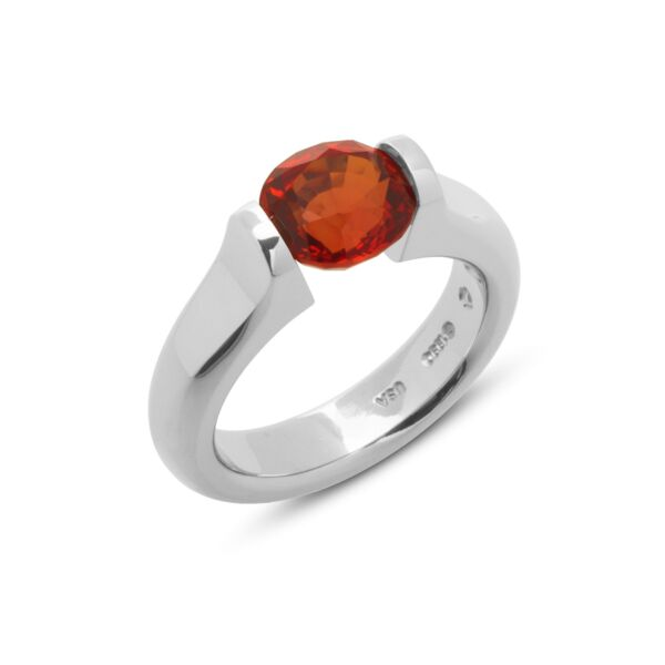 Closeup photo of 3.08 ct. Orange Sapphire set in Omega Flat Ring