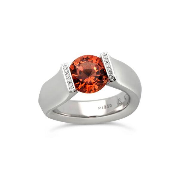 Closeup photo of 2.68 ct. Orange Sapphire set in Fancy Figure-8 Ring