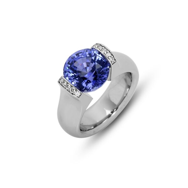 Closeup photo of 5.66 ct. Unheated Blue Sapphire set in Omega Round Ring