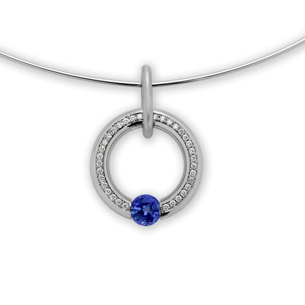 Closeup photo of Large Round Pave Pendant with a Blue Sapphire