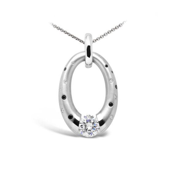 Closeup photo of Small Diamond Oval pendant featuring Black Diamonds