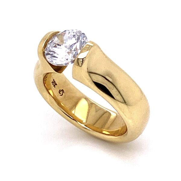 Closeup photo of Wide Omega Round Engagement Ring in Shiny 18K Yellow Gold for 1.55ct Round