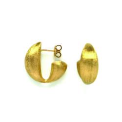 Closeup photo of Transformista Hoop Earrings