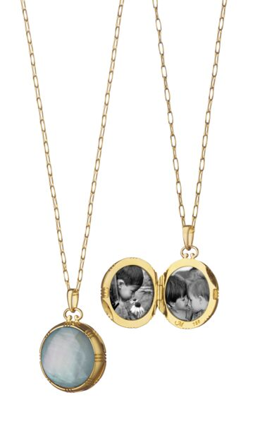 Closeup photo of Blue Topaz And Mother Of Pearl Locket