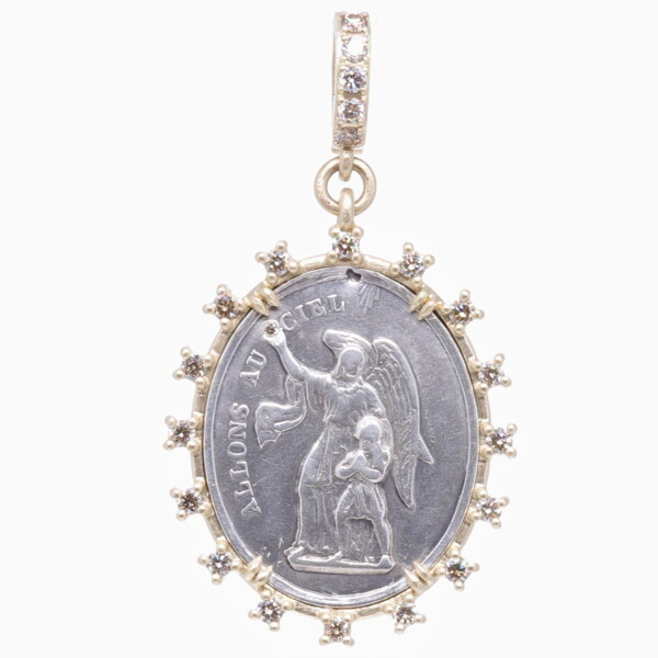 Closeup photo of Antique French Guardian Angel Pendant