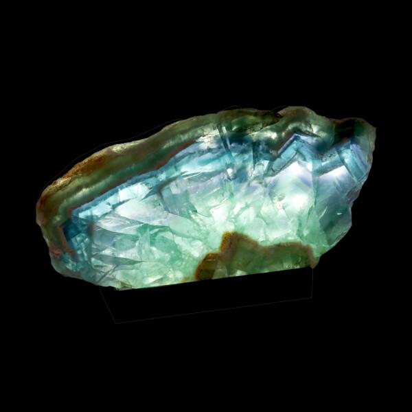Closeup photo of Fluorite Slice On Custom Illuminated Stand with Natural Edge